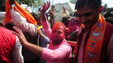 Voters celebrate outside the in Lucknow on March 11, 2017.