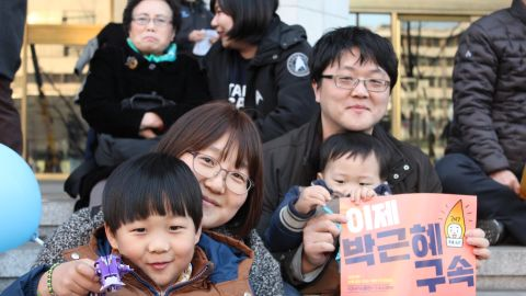 """Lee Dong-sun, 36, brought her children to the demonstration celebrating Park's impeachment. """"Before, when there were other protests, I would just sit at home, even when I agreed,"""" she said. """"But after I had children, I felt I could no longer ride on the backs of others ... to bring them the future I desire."""""""