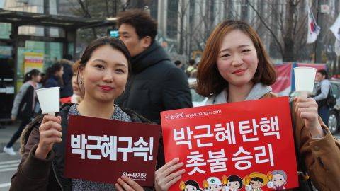 """""""Today is just the beginning,"""" said Kim Ga-hyun, 26 (left). Her friend Kim Bo-hee, 24, said that after months of protests, it was good to have a """"day of celebration."""""""