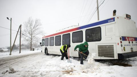 Blaine Webb helps a SEPTA employee shovel out a bus from the snow March 14, 2017 in Spring City, Pennsylvania.