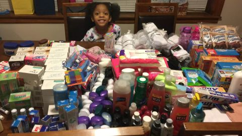Armani Crews prepares care packages with donated toiletries for a food drive for the homeless on her 6th birthday.