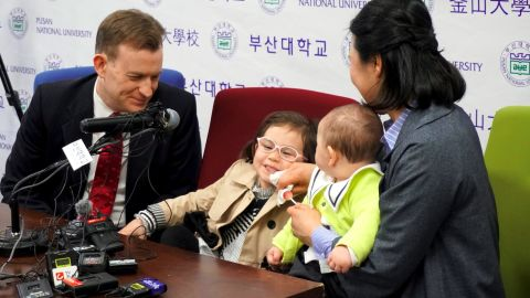 Robert Kelly with his wife Kim Jung-A, daughter Marion and son James attend a press conference in Busan on March 15.