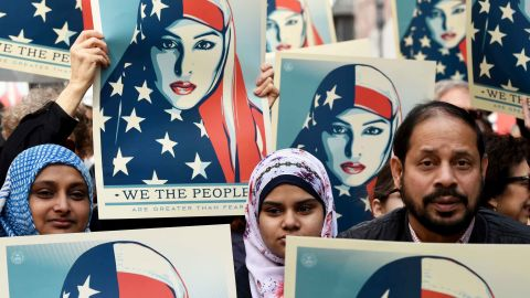 Protesters march in New York's Times Square in solidarity with American Muslims and against the travel ban ordered by US President Donald Trump on February 19, 2017. / TIMOTHY A. CLARY/AFP/Getty Images