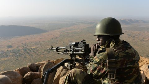 A Cameroonese soldier holds a position on Febuary 16, 2015 near the village of Mabass, northern Cameroon. Cameroon's army announced on February 17, 2014 having killed 86 Boko Haram militants and detained 1,000 people suspected of links to the Islamist group, as central African leaders held talks on how to combat its bloody insurgency.  Five Cameroonian soldiers were also killed during the clashes in the Waza region near the border with Nigeria, defence ministry spokesman said. AFP PHOTO REINNIER KAZE        (Photo credit should read Reinnier KAZE/AFP/Getty Images)