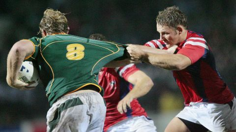 Dan Payne (R) tackles South Africa's Schalk Burger during a match at the 2007 Rugby World Cup.