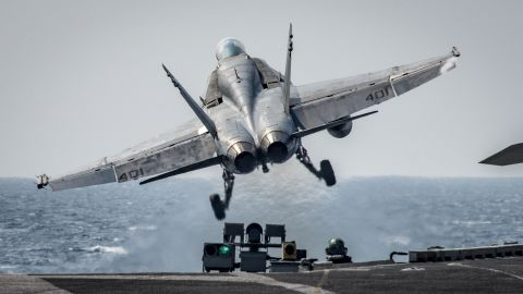 """170312-N-BL637-010 SEA OF JAPAN (March 12, 2017) An F/A-18C Hornet assigned to the """"Blue Blasters"""" of Strike Fighter Squadron (VFA) 34 takes off from the aircraft carrier USS Carl Vinson (CVN 70). The ship and its carrier strike group are on a regularly scheduled Western Pacific deployment as part of the U.S. Pacific Fleet-led initiative to extend the command and control functions of U.S. 3rd Fleet. U.S. Navy aircraft carrier strike groups have patrolled the Indo-Asia-Pacific regularly and routinely for more than 70 years. (U.S. Navy photo by Mass Communication Specialist 2nd Class Sean M. Castellano/Released)"""