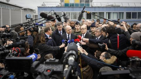 French Interior Minister Bruno le Roux, center, and French Defense Minister Jean-Yves le Drian answer reporters at Orly airport, south of Paris, after an airport shooting earlier this month.