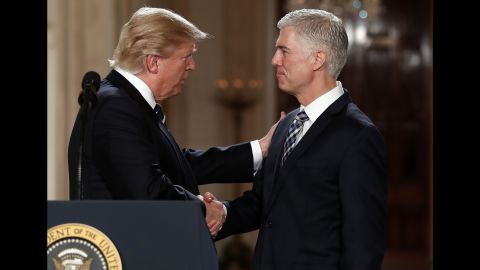 President Donald Trump shakes hands with Gorsuch in the East Room of the White House in January 2017.