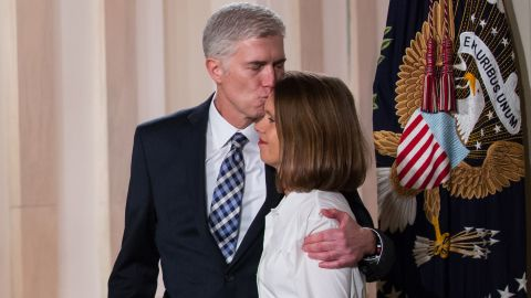 Gorsuch, with his wife by his side, listens to Trump announce his Supreme Court nomination.