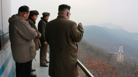 """TOPSHOT - This undated picture released by North Korea's official Korean Central News Agency (KCNA) on March 19, 2017 shows North Korean leader Kim Jong-Un (R) inspecting the ground jet test of a newly developed high-thrust engine at the Sohae Satellite Launching Ground in North Korea. North Korea has tested a powerful new rocket engine, state media said on March 19, with leader Kim Jong-Un hailing the successful test as a """"new birth"""" for the nation's rocket industry. / AFP PHOTO / KCNA VIA KNS / STR / South Korea OUT / REPUBLIC OF KOREA OUT   ---EDITORS NOTE--- RESTRICTED TO EDITORIAL USE - MANDATORY CREDIT """"AFP PHOTO/KCNA VIA KNS"""" - NO MARKETING NO ADVERTISING CAMPAIGNS - DISTRIBUTED AS A SERVICE TO CLIENTS THIS PICTURE WAS MADE AVAILABLE BY A THIRD PARTY. AFP CAN NOT INDEPENDENTLY VERIFY THE AUTHENTICITY, LOCATION, DATE AND CONTENT OF THIS IMAGE. THIS PHOTO IS DISTRIBUTED EXACTLY AS RECEIVED BY AFP.    /         (Photo credit should read STR/AFP/Getty Images)"""
