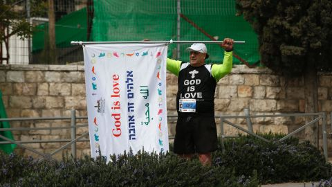 """This competitor carried a flag with the message, """"God is love."""""""