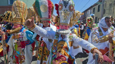 Marchers in Philadelphia's El Carnaval de Puebla dance during the city's 2013 celebration.