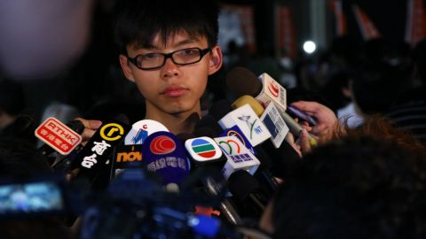 A 15-year-old Joshua Wong talks to the press at a Scholarism rally in July 2012.