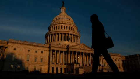 WASHINGTON, D.C. - MARCH 20:  A person walks by as the sun rises near The United States Capitol Building on March 20, 2017 in Washington, D.C.  (Photo by Zach Gibson/Getty Images)