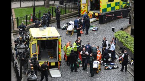 Emergency workers attend to injured people at the scene.