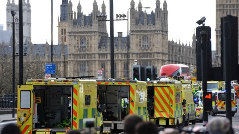 """Ambulances wait as members of the emergency services work on Westminster Bridge, alongside the Houses of Parliament in central London on March 22, 2017, during an emergency incident. British police shot a suspected attacker outside the Houses of Parliament in London on Wednesday after an officer was stabbed in what police said was a """"terrorist"""" incident. One woman has died and others have """"catastrophic"""" injuries following a suspected terror attack outside the British parliament, local media reported on Wednesday citing a junior doctor. / AFP PHOTO / NIKLAS HALLE'N        (Photo credit should read NIKLAS HALLE'N/AFP/Getty Images)"""