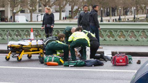 Medics treat a victim on Westminster Bridge.