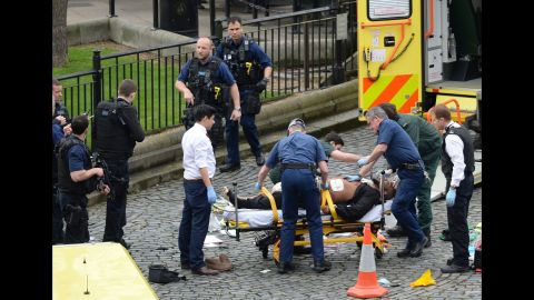 """Masood is treated by emergency services as police look on at the scene outside the Houses of Parliament. The Metropolitan Police say he was born in Kent, but is believed to have been living in the West Midlands recently. Police say Masood was also known by a number of aliases. """"Masood was not the subject of any current investigations and there was no prior intelligence about his intent to mount a terrorist attack,"""" Met Police said in a statement."""