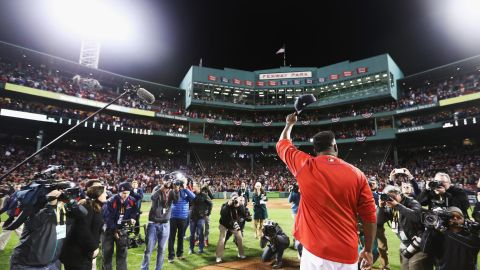 David Ortiz of the Boston Red Sox raises his cap after his team's defeat in Game 3 of the 2016 American League Division Series.