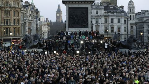 A somber crowd gathers in London's Trafalgar Square at the vigil for the victims of Wednesday's attack.