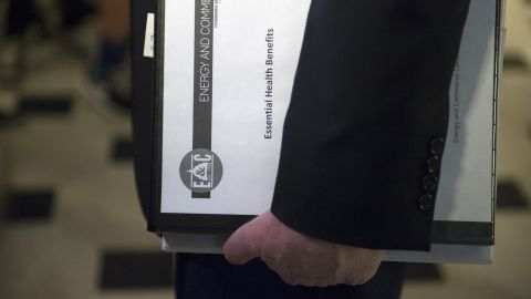 """US Rep. Greg Walden, the House Energy and Commerce Committee chairman and one of the stewards of the Republican health care legislation, carries a binder labeled """"Essential Health Benefits"""" as he leaves House Speaker Paul Ryan's office on Capitol Hill on Friday, March 24. The health care bill overhaul was <a href=""""http://www.cnn.com/2017/03/24/politics/house-health-care-vote/index.html"""" target=""""_blank"""">pulled from a floor vote</a> later that day."""