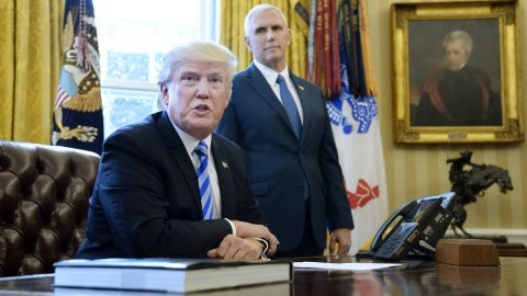 """President Donald Trump speaks to members of the media as Vice President Mike Pence looks on in the Oval Office on Friday, March 27, after Republicans were forced to pull a health care bill that aimed to repeal and replace Obamacare. """"We had no votes from the Democrats. They weren't going to give us a single vote, so it's a very very difficult thing to do,"""" <a href=""""http://www.cnn.com/2017/03/24/politics/donald-trump-health-care-blame/index.html"""" target=""""_blank"""">Trump said</a>."""