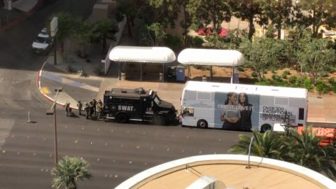 A SWAT vehicle sits in front of the bus on Las Vegas Boulevard.