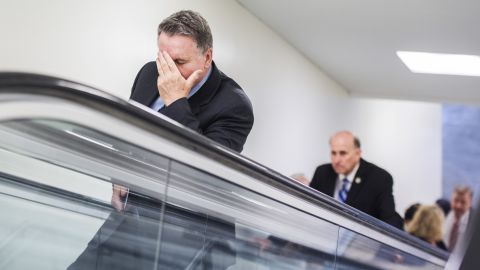 """US Rep. Chris Smith puts his hand to his face as he makes his way on Friday, March 24, to a meeting in Washington where House Speaker Paul Ryan announced <a href=""""http://www.cnn.com/2017/03/24/politics/house-health-care-vote/"""" target=""""_blank"""">the vote for the American Health Care Act had been canceled</a>."""