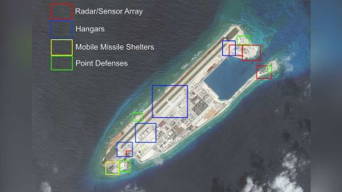 A satellite photo of China's artificial island on Fiery Cross Reef, taken on March 9, and highlighted by AMTI.