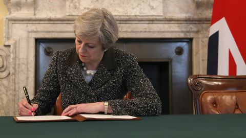 British Prime Minister Theresa May signs the official letter to European Council President Donald Tusk invoking Article 50.
