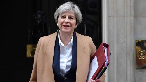 British Prime Minister Theresa May leaves 10 Downing Street before heading to the Houses of Parliament.