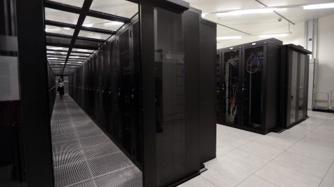 """A picture taken on September 17, 2013 in Saint-Denis, outside Paris, shows a room of cabling servers """"clients"""" at the French branch of Digital Realty, a company involved in datacenter acquisition, ownership, development and operation. Digital Realty's customers include domestic and international companies across multiple industry verticals ranging from information technology and Internet enterprises, to manufacturing and financial services.     AFP PHOTO/JACQUES DEMARTHON        (Photo credit should read JACQUES DEMARTHON/AFP/Getty Images)"""