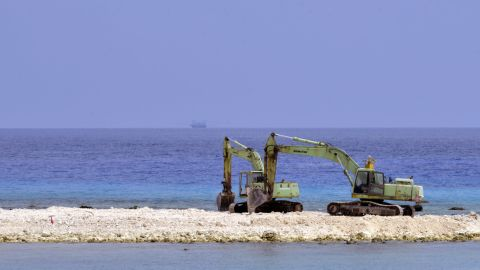 Two excavators are pictured at a construction site on Taiping island in the Spratly chain in the South China Sea on March 23, 2016. Taiwan on March 23 gave its first ever international press tour of a disputed island in the South China Sea to boost its claim, less than two months after a visit by its leader sparked protests from rival claimants.  / AFP / SAM YEH        (Photo credit should read SAM YEH/AFP/Getty Images)