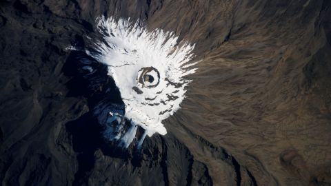 A crew member on the International Space Station captured this image of  Mount Kilimanjaro, Tanzania, covered in snow and ice in 2007.