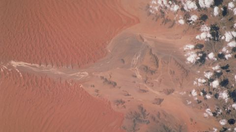 Winds moving north caused the deep red dunes that can be seen in this image of the Sossus Vlei clay pan in Namibia, taken by an astronaut in 2001.