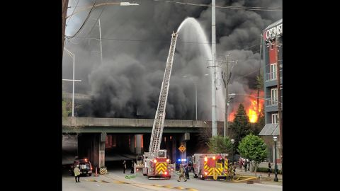 Flames reach as high as 40 feet at the height of the fire in northeast Atlanta.