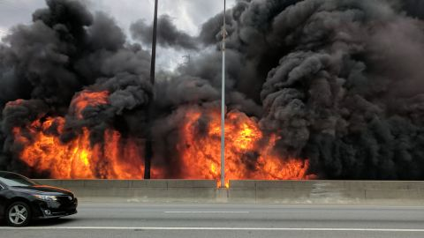 Flames quickly engulf a stretch of northbound Interstate 85 on Thursday evening in Atlanta.