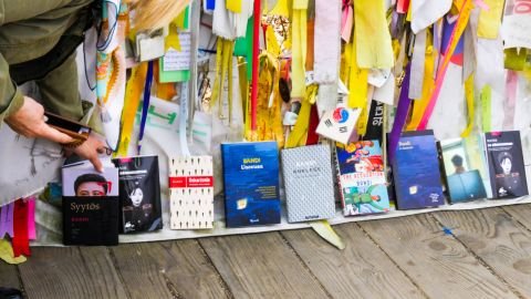 """Copies of """"The Accusation"""" translated into different languages are placed next to each other Thursday on the Bridge of Freedom at Imjingak in Paju."""