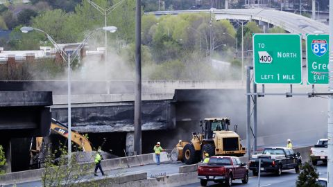 Crews work Friday on a section of I-85 that collapsed during a masive fire.