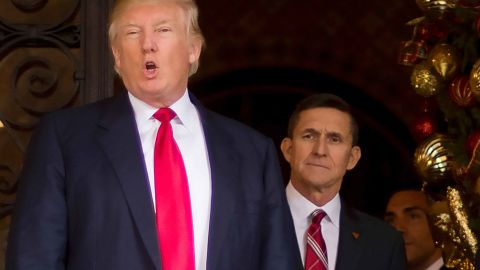 """(FILES): This December 21, 2016 file photo shows US President-elect Donald Trump (L) with with Trump National Security Adviser designate Lt. General Michael Flynn (R) at Mar-a-Lago in Palm Beach, Florida.The White House announced February 13, 2017 that Michael Flynn has resigned as President Donald Trump's national security advisor, amid escalating controversy over his contacts with Moscow. In his formal resignation letter, Flynn acknowledged that in the period leading up to Trump's inauguration: """"I inadvertently briefed the vice president-elect and others with incomplete information regarding my phone calls with the Russian ambassador.""""Trump has named retired lieutenant general Joseph Kellogg, who was serving as a director on the Joint Chiefs of Staff, as acting national security advisor, the White House said. / AFP PHOTO / JIM WATSON / XGTYJIM WATSON/AFP/Getty Images"""