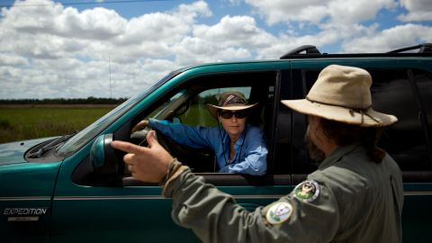 Before heading to her next hunting spot, Kalil chats with fellow python hunter Tom Rahill.