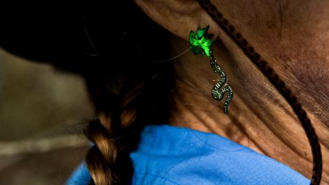 Kalil sports snake earrings during the hunt.