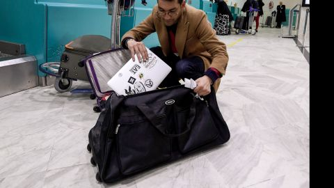A Libyan traveller packs his laptop in his suitcase before boarding his flight for London at Tunis-Carthage International Airport on March 25, 2017.The United States this week announced a ban on all electronics larger than a standard smartphone on board direct flights out of eight countries across the Middle East, in effect from March 25, 2017. US officials would not specify how long the ban will last, but Emirates told AFP that it had been instructed to enforce the measures until at least October 14. Britain has also announced a parallel electronics ban targeting all flights out of Egypt, Turkey, Jordan, Saudi Arabia, Tunisia and Lebanon. / AFP PHOTO / FETHI BELAID        (Photo credit should read FETHI BELAID/AFP/Getty Images)
