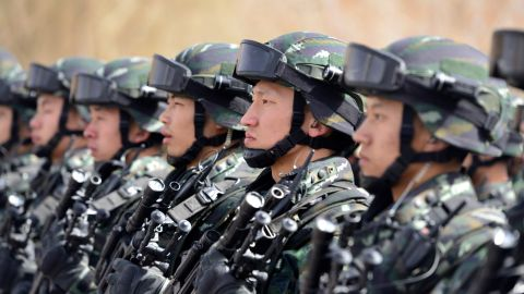 Chinese military police attend an anti-terrorist oath-taking rally in Xinjiang.