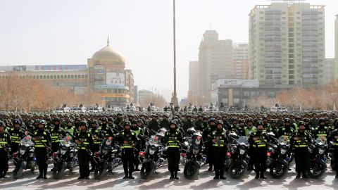"""This photo taken on February 27, 2017 shows Chinese police attending an anti-terrorist oath-taking rally in Hetian, northwest China's Xinjiang Uighur Autonomous Region.  Islamic State militants from China's Uighur ethnic minority have vowed to return home and """"shed blood like rivers"""", according to a jihadist-tracking firm, in what experts said marked the first IS threat against Chinese targets. The threat came in a half-hour video released on February 27 by a division of the Islamic State in western Iraq and featuring militants from China's Uighur ethnic group, said the US-based SITE Intelligence Group, which analysed the footage. / AFP / STR / China OUT        (Photo credit should read STR/AFP/Getty Images)"""