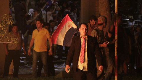 Anti-government protesters storm Paraguay's congressional building Friday night in Asunción.