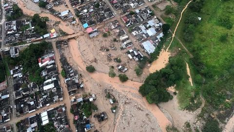 An aerial view shows the devastation Saturday, April 1, after heavy rains caused rivers to overflow in Mocoa, Colombia.