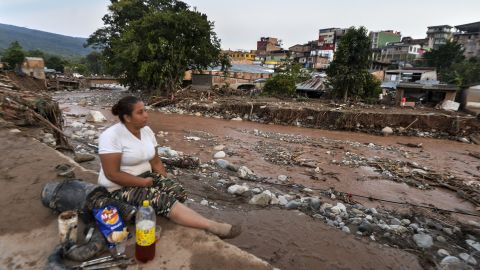 A woman surveys some of the damage in Mocoa.