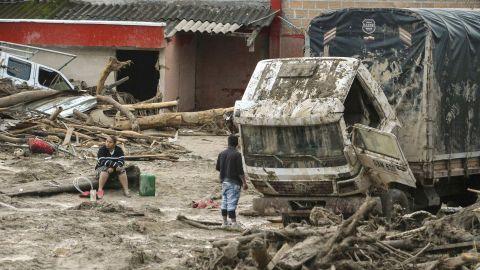 The day after a mudslide hit Mocoa, people walk among the devastation on  April 2.