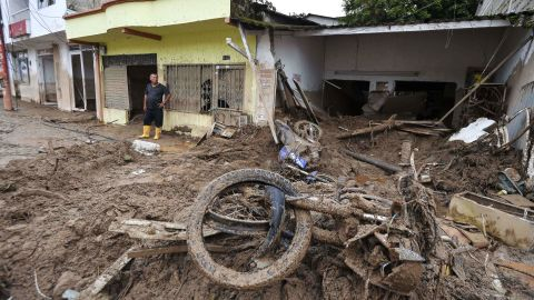 A resident stares at the rubble left by the mudslides.